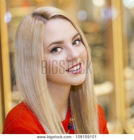 Close up, Beautiful young blonde woman in shop