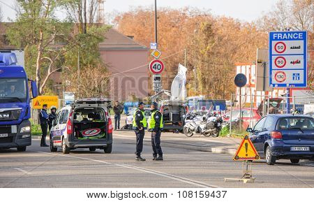 STRASBOURG FRANCE - NOV 14 2015: French Police checking vehicles on the 'Bridge of Europe' between Strasbourg and Kehl Germany as a security measure in the wake of attacks in Paris