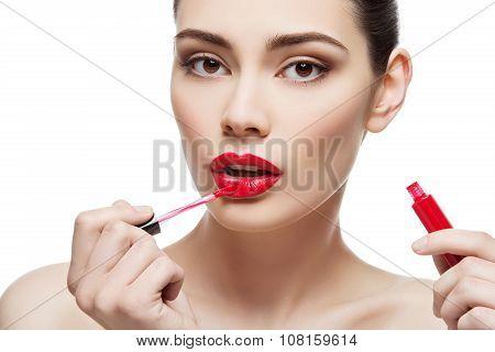 Beautiful girl with lipgloss