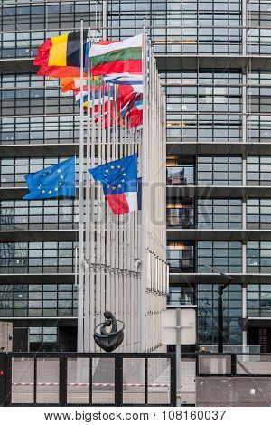STRASBOURG, FRANCE - 14 Nov 2015: European Union Flags and France flag flies at half-mast in front of the European Parliament building following an terrorist attack in Paris