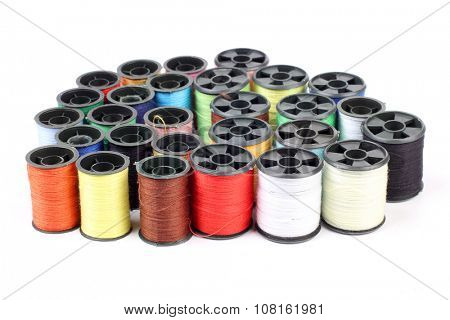 Spools of colored thread on a white background