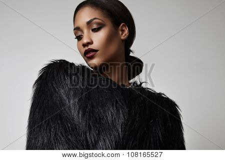 Blck Woman In A Black Faux Fur Jacket