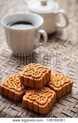 Retro Vintage Style Chinese Mid Autumn Festival Foods. Traditional Mooncakes On Table