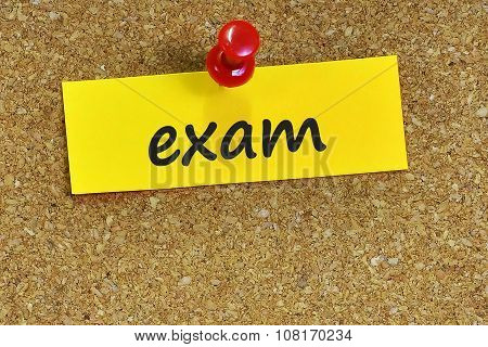 Exam  Word On Notes Paper With Cork Background