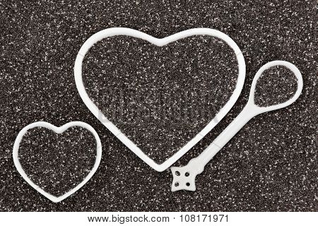 Chia seed health food in heart shaped porcelain bowls and spoon forming an abstract background.