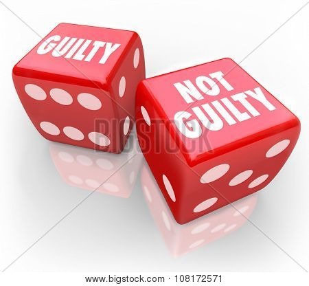 Guilty or Not Guilty words on two red dice to illustrate being convicted or acquitted in a court of law in judgment from a jury or judge in trial