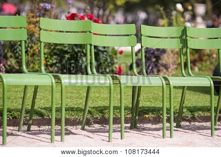 Traditional green chairs in the Tuileries garden in Paris, France
