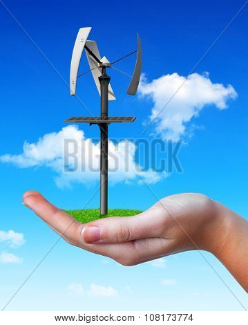 Wind turbine in hand. Clean energy concept.