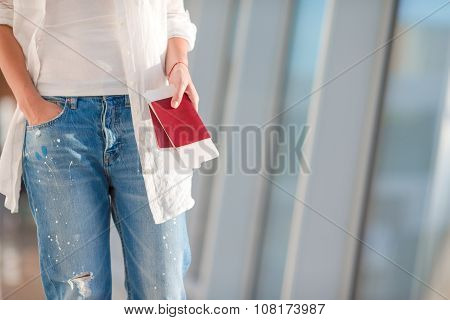 Two passports and boarding pass in pocket at airport
