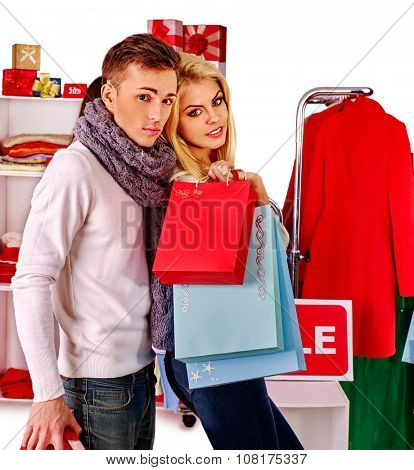 Shopping couple with bags at Christmas sales.
