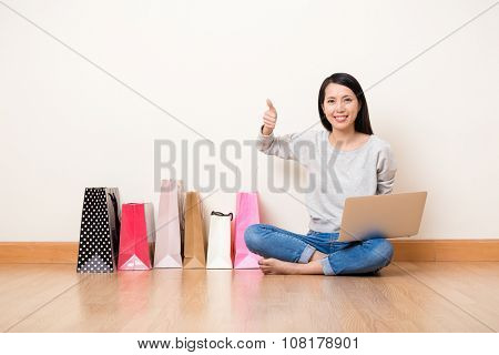 Woman like online shopping though laptop computer