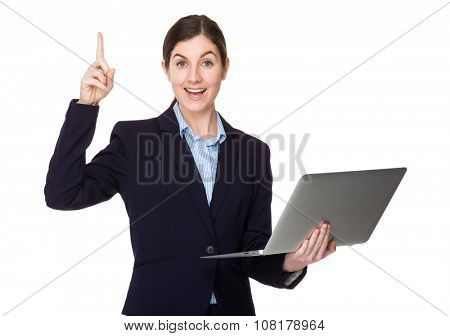 Businesswoman with laptop computer and finger up