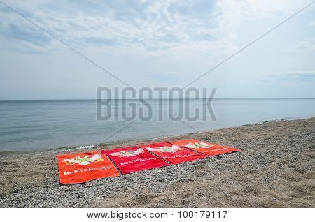 Siberia, Ru-aug,1 2015:four Identical Beach Montenegro Towels On Sandy Shore Of Lake Baikal
