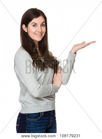 Caucasian woman with hand showing blank sign