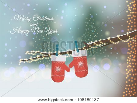 Christmas greeting card with red knitted mittens