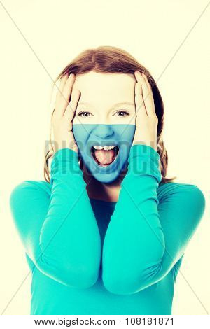 Woman with San Marino flag painted on face.