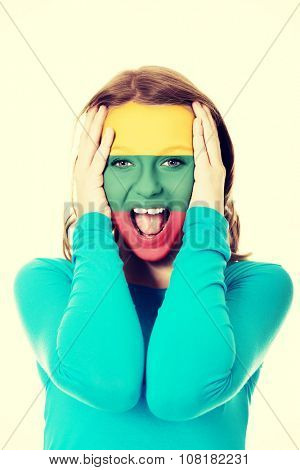 Woman with Lithuania flag painted on face.