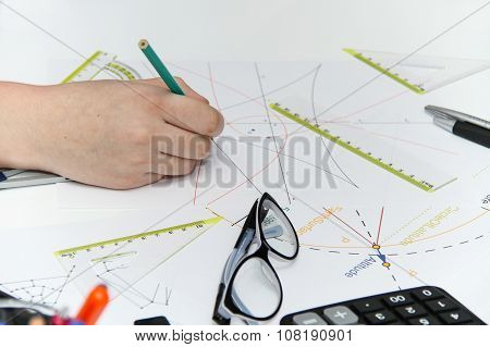 Young Female Designer Working With Architectural Plan