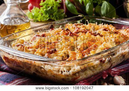 Casserole Fusilli Pasta With Sausage, Zucchini And Cheese