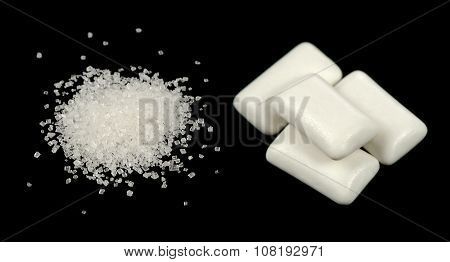 Sugar And Chewing Gum Pellets On Black Background