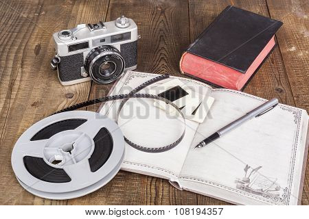 Camera And Open Notebook