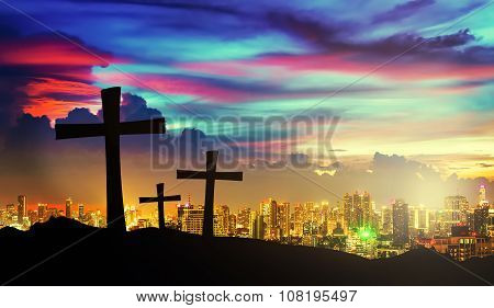 Cross Silhouette On Mountain With Twilight Sky And Cityscape On Background.