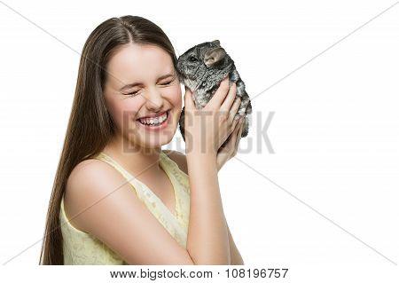 Pet chinchilla kissing owner