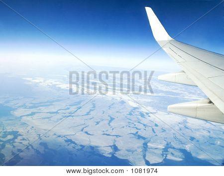 Flight Over Frozen Lake