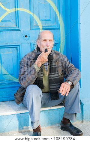 VALPARAISO - NOVEMBER 07: Unknown man in front of door in Alegre districts of the protected UNESCO World Heritage Site of Valparaiso on November 7 2015 in Valparaiso Chile