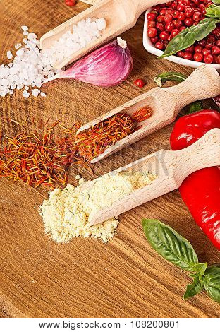 Spices And Seasonings On A Wooden Background