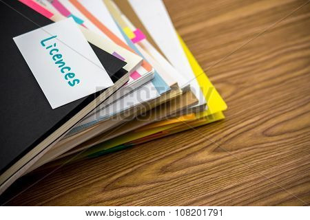 Licences; The Pile Of Business Documents On The Desk
