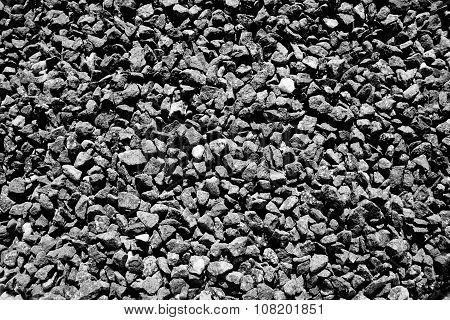 Black & white image background of crushed stones