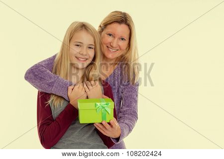 Blond Girl And Woman With Gift Box