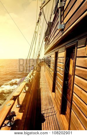 Wooden sailboat in sea