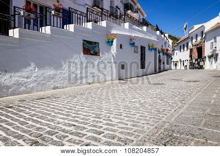 Picturesque Street Of Mijas With Flower Pots In Facades. Andalusian White Village. Costa Del Sol. So