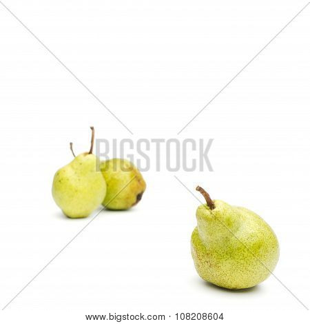 Three Williams Sort Pears Isolated Against White Background Selective Focus