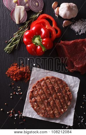 Raw Beef Burger Steak Cutlets With Ingredients Closeup. Vertical Top View