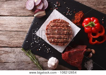 Raw Burgers Cutlets With The Ingredients. Horizontal Top View