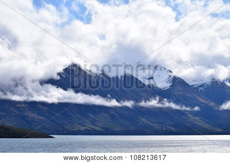 Snow-capped mountain shrouded in clouds