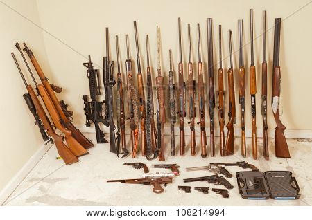 Large gun collection of rifles, shotguns, and handguns