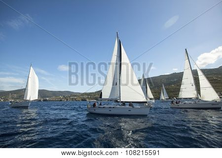 HYDRA, GREECE - CIRCA OCT, 2014: Sailboats participate in sailing regatta Ellada Autumn 2014 among Greek island group in the Aegean Sea, in Cyclades and Argo-Saronic Gulf.