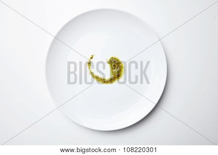 Pesto Sause Spoiled On White Blank Plate Isolated Top View