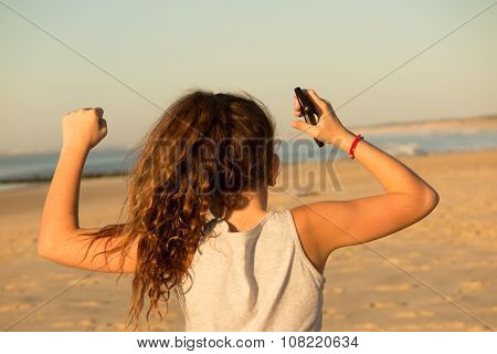 Rear View Of A Young Girl At The Beach On Holidays