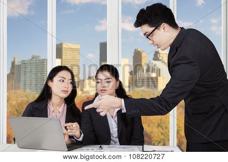 Businessman Discussing With Two Businesswomen