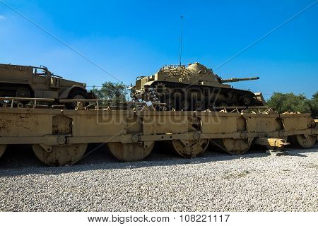 M60 Patton Tank With M9 Dozer Blade And M3 Half-track Carrier On Pontoon Bridge. Latrun, Israel