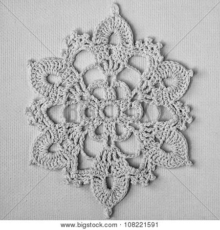 Crocheted white snowflake