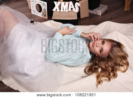 Girl Wears Knitted Cardigan And Fatin Skirt,posing Beside Christmas Tree