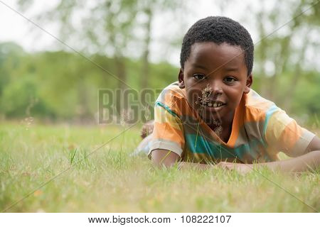 African Boy In The Grass