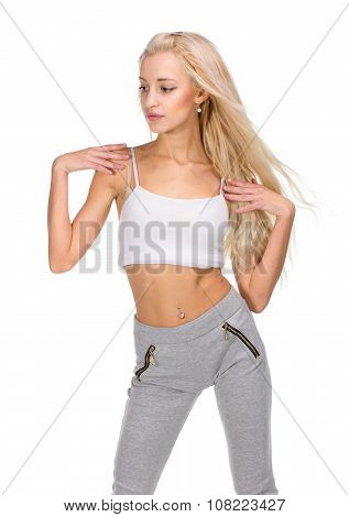 Young slim beautiful woman warming up before working out, isolated studio image on white background