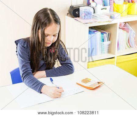 Asian American Girl Using Calculator